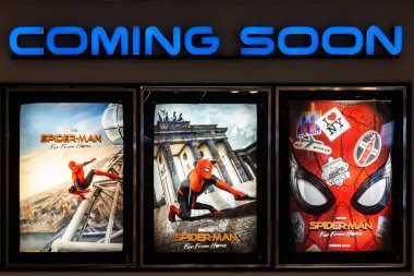 Bangkok, Thailand - Jun 26, 2019: Spider-Man: Far From Home movie poster with coming soon display showing in theatre. Cinema promotional advertisement, or film industry marketing concept