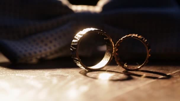 Composition of two wedding golden rings at the table.