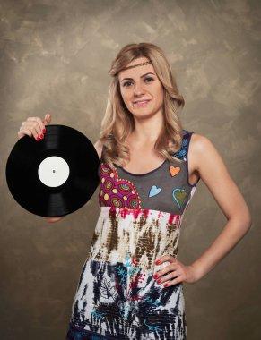 Cheerful girl holding a vinyl