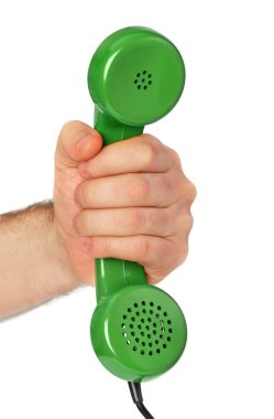 Hand holding an old telephone receiver