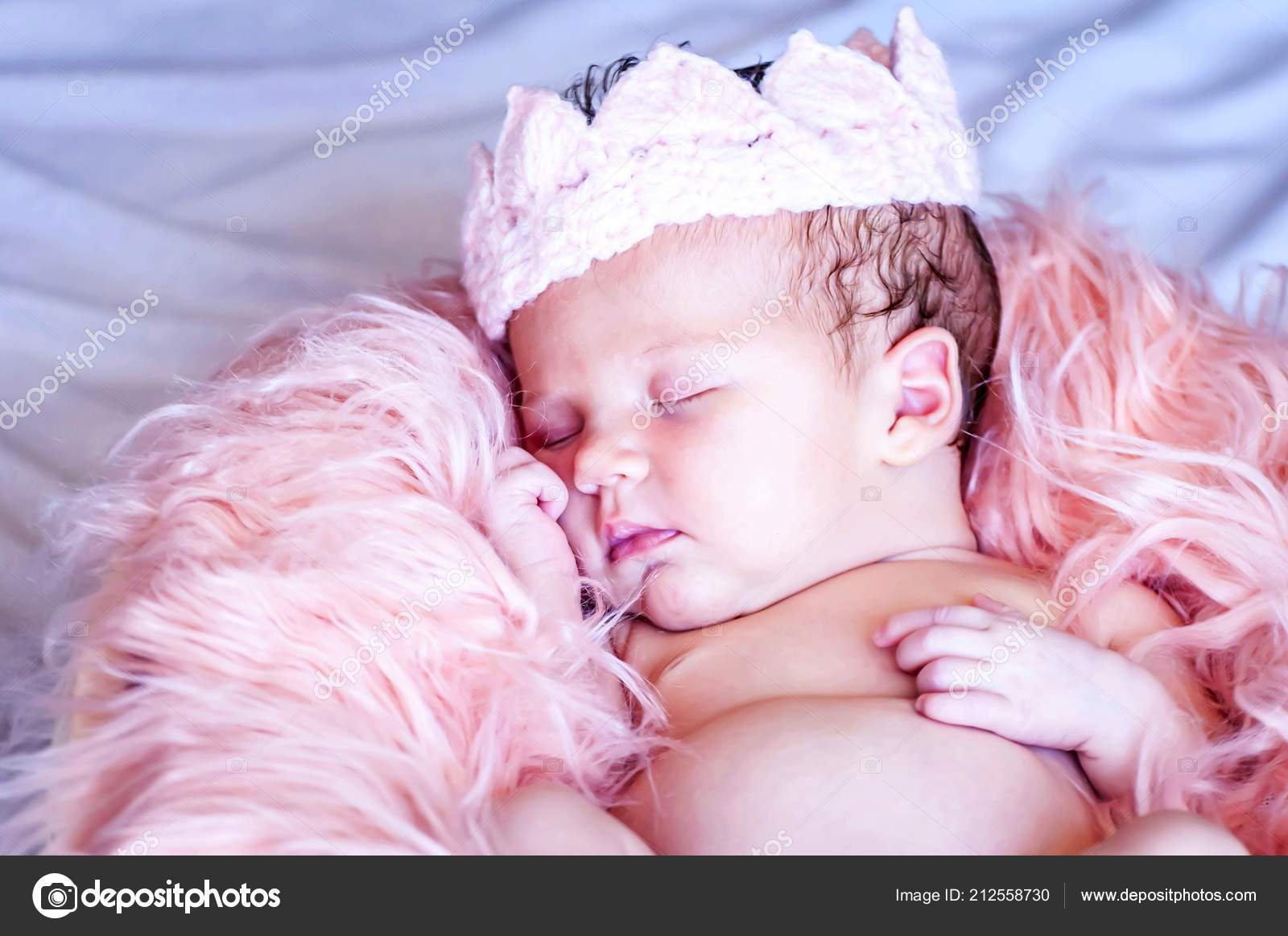 Cute caucasian newborn baby girl in a textile crown sweet little princess concept image newborn studio photo session idea photo by roman yanushevsky