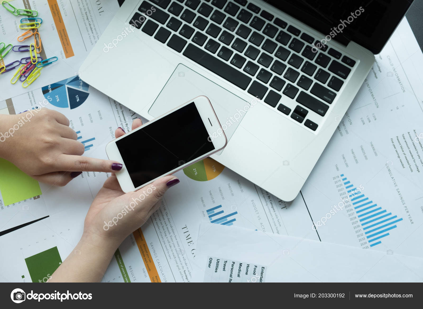 Top Business Laptops 2020.Top View Business Woman Using Smartphone Financial Document