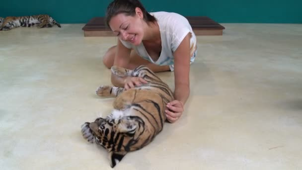 Girl playing with Tiger Cub
