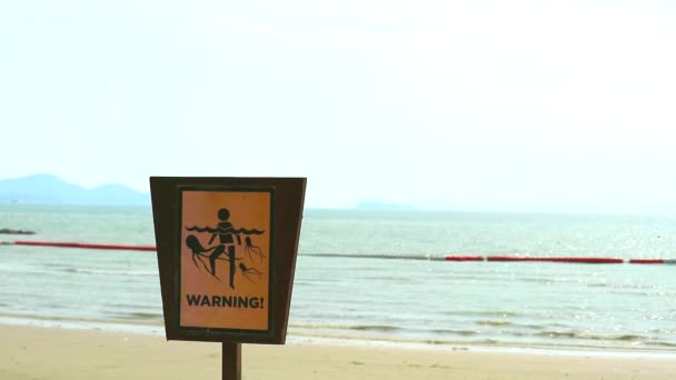 Warning sign to be careful of jelly fish when playing in the water