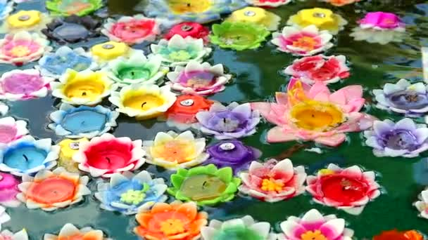 rainbow beautiful Floating candle on water surface in pond