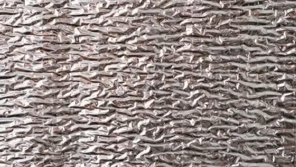 Silvery shiny wall coating, heat insulation material