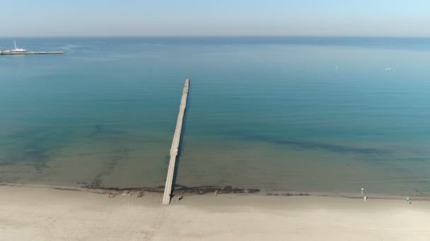 Aerial view photography over the sea. Black sea port and pier from the height.