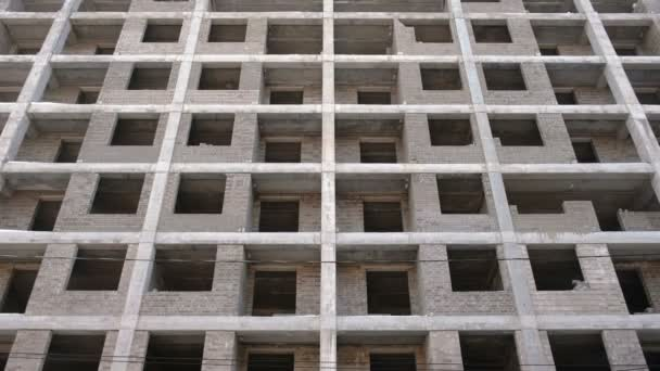 Multi-storey residential building under construction. Front view, camera moving up.