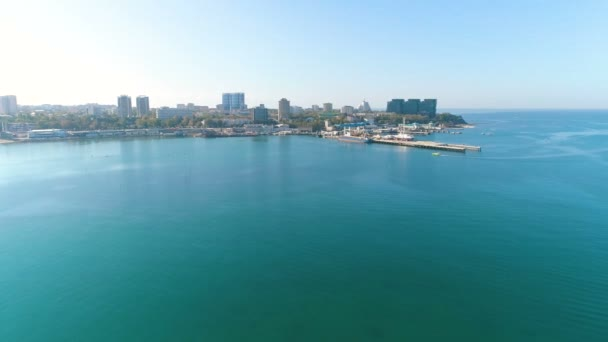 Aerial view photography over the sea port and sity on a sunny day, beautiful sesascape