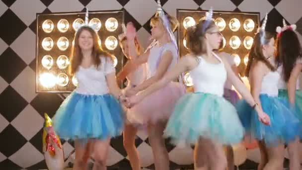 Happy funny lifestule girls in colorful skirts laughing, having fun, celebrating hen day or night out party