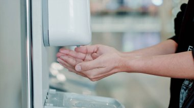 Woman hand are using alcohol gel to wash their hands to protect virus or germ.Health and beauty concepts.