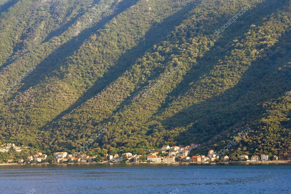 Rhythmic texture of a steep mountain slope, illuminated by the sun. Montenegro, Bay of Kotor