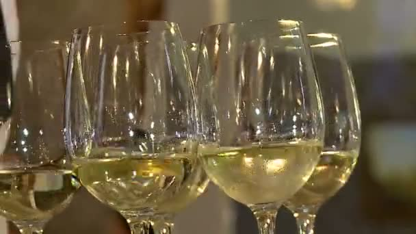 Beautiful glasses with white wine on a tray