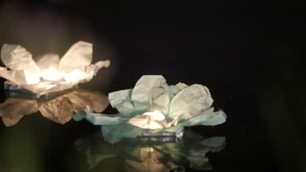Running water flashlight. The glow of lanterns on the water.