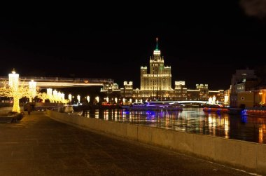 Moscow, Russia - January 10, 2018: Christmas illuminations on Moskvoretskaya embankment. High-rise building on Kotelnicheskaya embankment