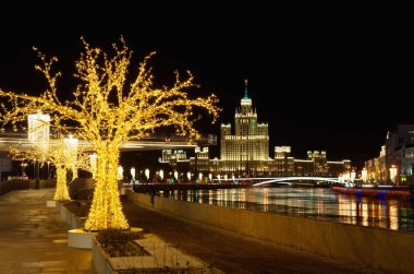 Moscow, Russia - January 10, 2018: Christmas illumination on Moskvoretskaya embankment. Night view of the high-rise building on Kotelnicheskaya embankment and Big Ustinsky bridge