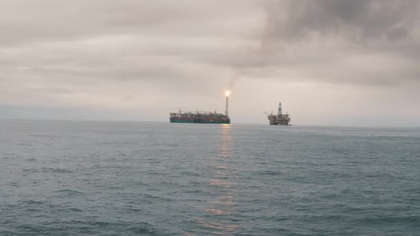 FPSO tanker vessel near Oil Rig platform  Offshore oil and gas industry