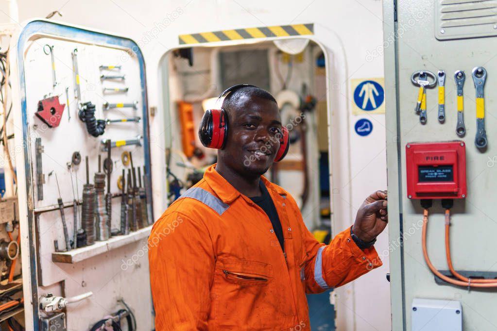 Marine engineer officer working in engine room