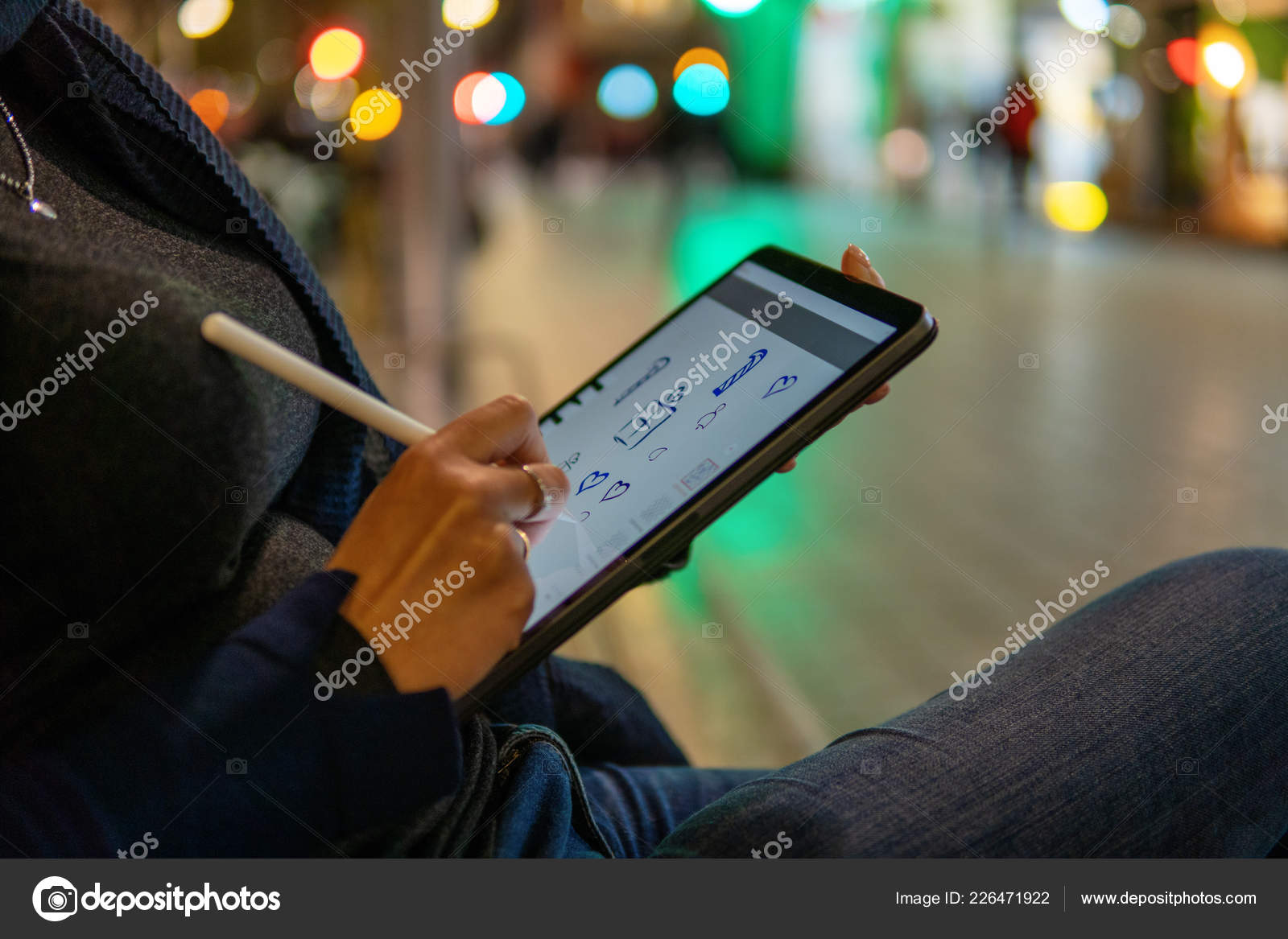 Woman Drawing On Digital Tablet With Stylus Pencil Stock Photo