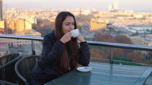 lady drinking coffee at outdoor cafe with amazing view in barcelona