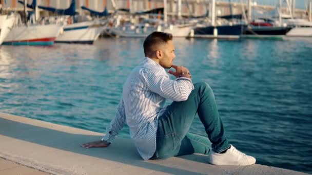 Young rich man at Yacht Club. Businessman is Relaxing
