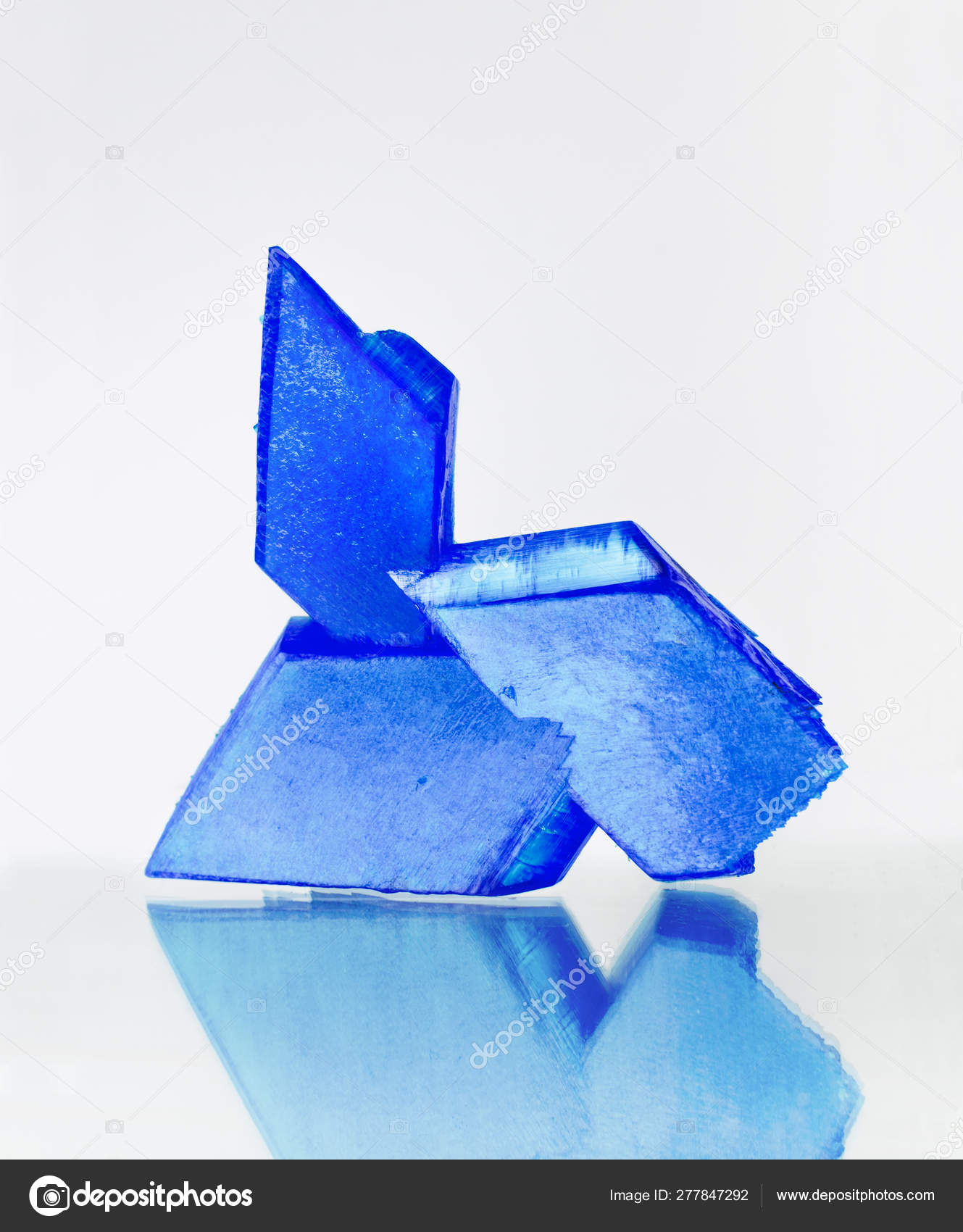 Blue Crystals Copper Sulfate Mirror Surface White Background Blue