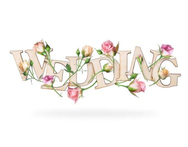 Wooden inscription wedding with branches of roses, isolated on white background