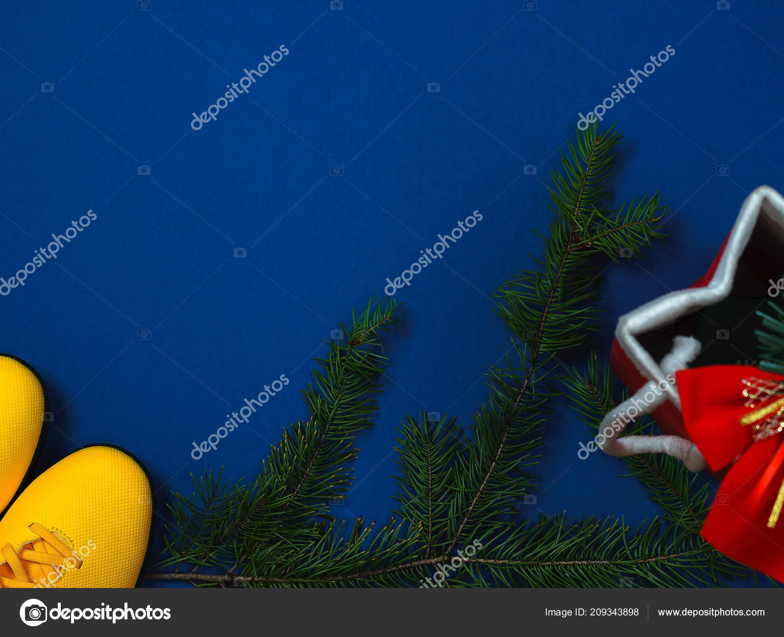 Christmas Sports Background.Sports Christmas Kit With Yellow Sneakers Branches Of