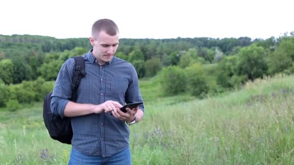 Man in a field with digital tablet