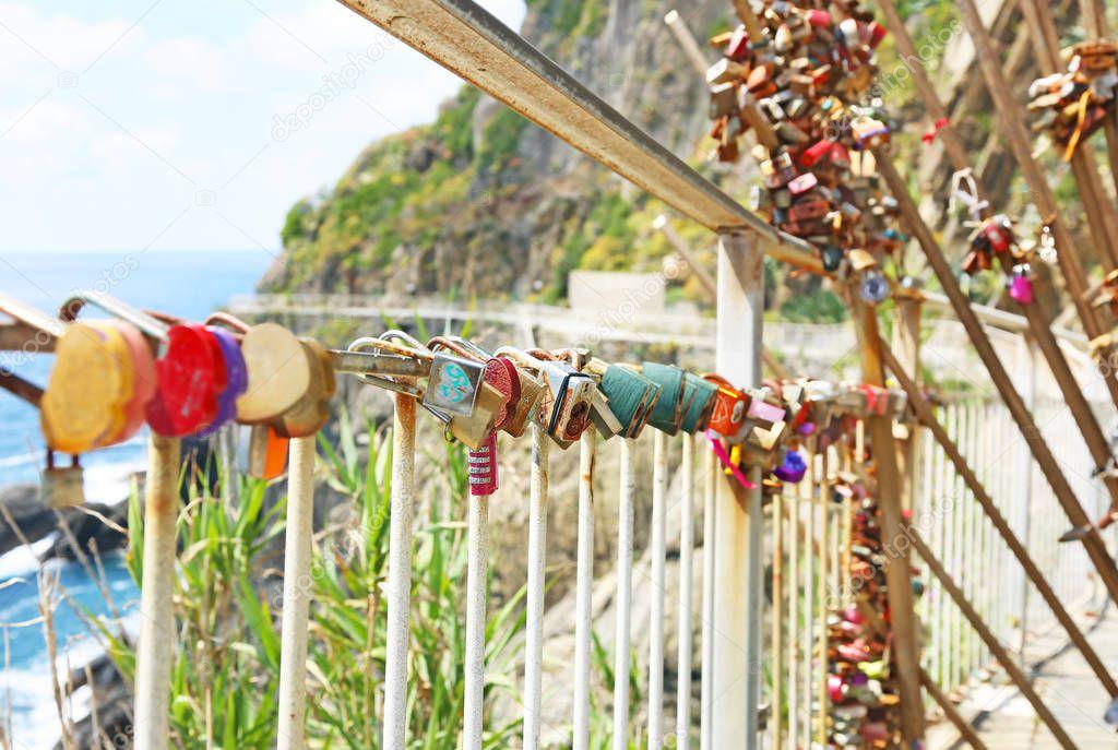 RIOMAGGIORE CINQUE TERRE ITALY, JUNE 01 2018: love padlocks at Riomaggiore village Cinque Terre Italy. Editorial use.