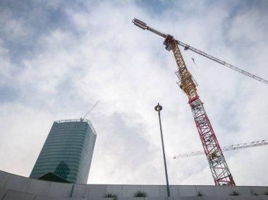 Futuristic skyscraper construction site, industry concept stock vector