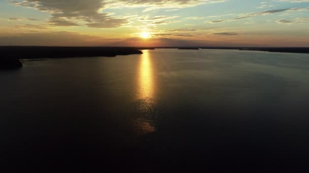 Aerial view. Amazing sky reflected in water. Beautiful sunset over the lake.