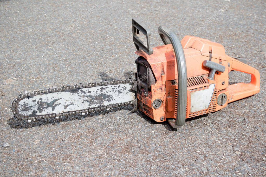 A well used chainsaw used by a tree surgeon