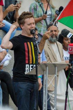 London, United Kingdom, 13th July 2018: Journalist Owen Jones, speaks at an anti Trump Rally in central London