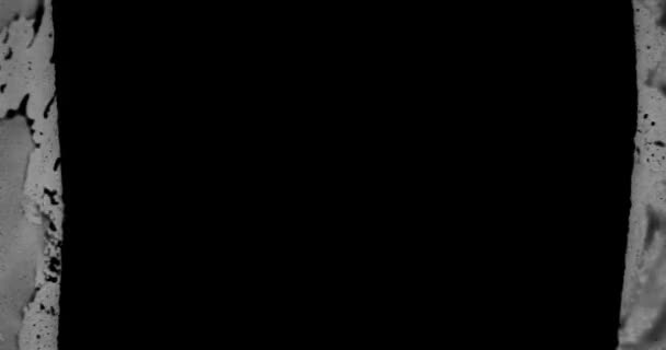 Grunge Stop Motion Frame texturované smyčka / 4k animace vintage pohybu grafiky s černou a bílou grunge ztrápený textury rámu pozadí bezešvé smyčky