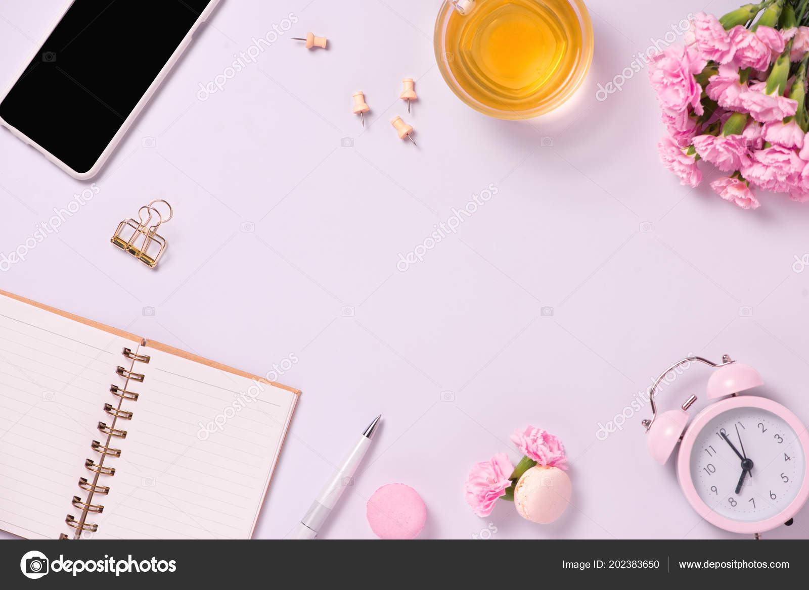 top view note book flowers pink background wedding planner concept