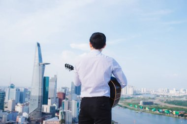 Musical Concept. Casual man playing practicing guitar.
