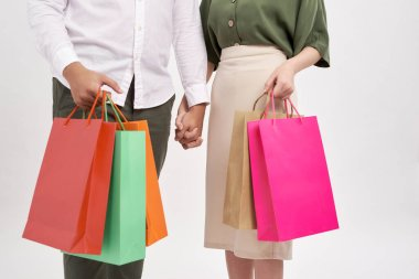 Woman and man holding shopping bags with copy space