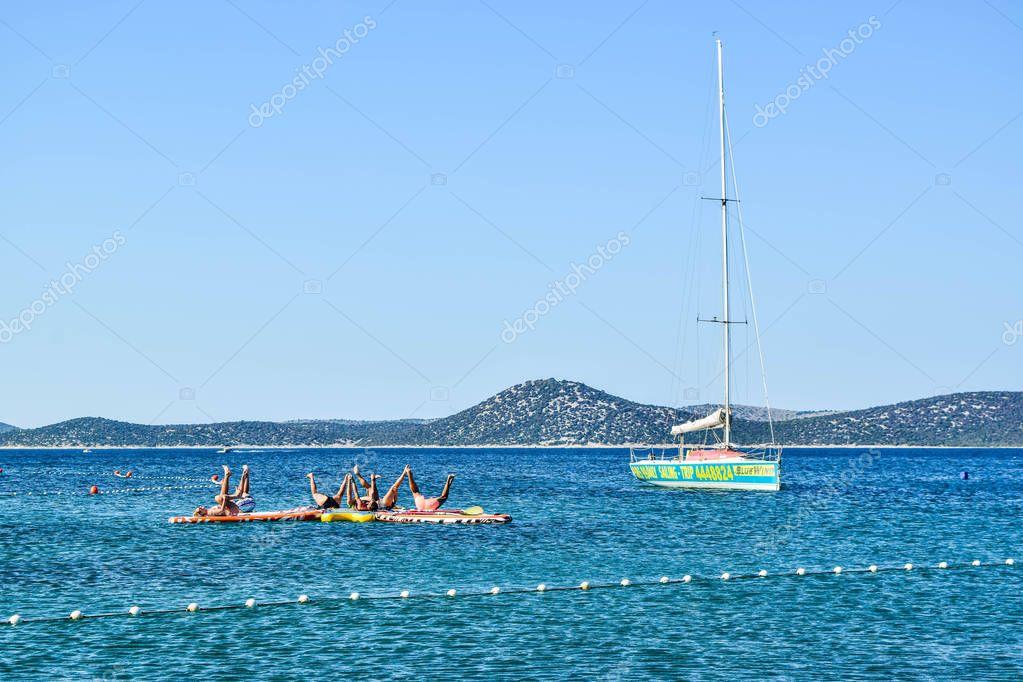 Vodice, Croatia - July 9, 2018: Group at aqua yoga classes.