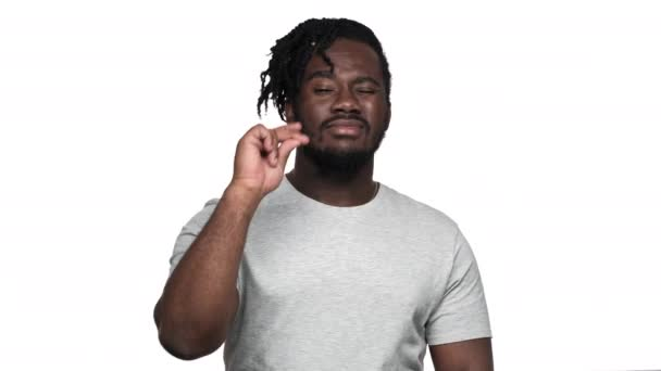 Portrait of flirty muscular african american man wearing afro hairdo and mustache gesturing at camera index finger meaning hey you, isolated over white background. Concept of emotions