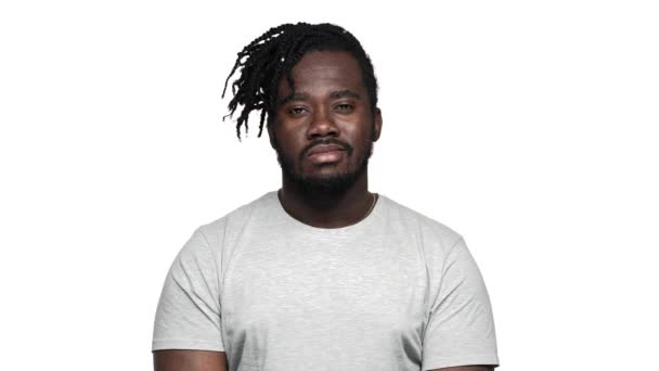 Portrait of joyous masculine african american man in casual t-shirt smiling at camera with perfect teeth, isolated over white background slow motion. Concept of emotions