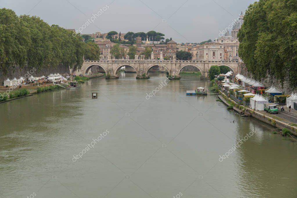 Rome, Italy - August 3, 2018: Tiber riverside in Rome, Italy, Italian Fiume Tevere, full of bars and restaurants on the embankment