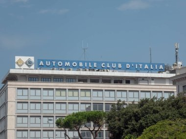 Rome, Italy - August 10, 2018: Automobile Club d'Italia signage on the top of a building. The Automobile Club d'Italia is a non-economic, self-financed statutory corporation of the Italian Republic