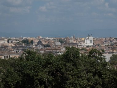 Rome cityscape with the Altar of the Fatherland (also known as Vittoriano or Vittorio Emanuele II Monument) on background