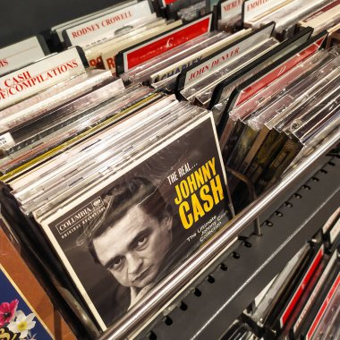 Berlin, Germany - October 12, 2019: Compact disc for sale The Ultimate Johnny Cash Collection and others