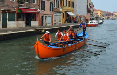 VENICE, ITALY -  SEPTEMBER 23, 2017: Venetain rowing team on the Cannaregio Canal Venice Italy.