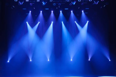 Free stage with lights, lighting devices. Background stock vector