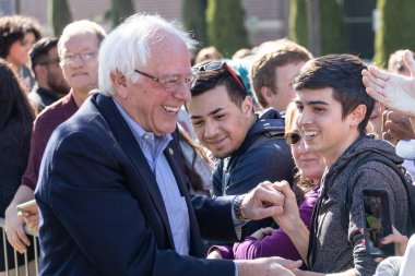 RENO, NV - October 25, 2018 - Bernie Sanders smiling while meeting with attendees in crowd at a political rally on the UNR campus.