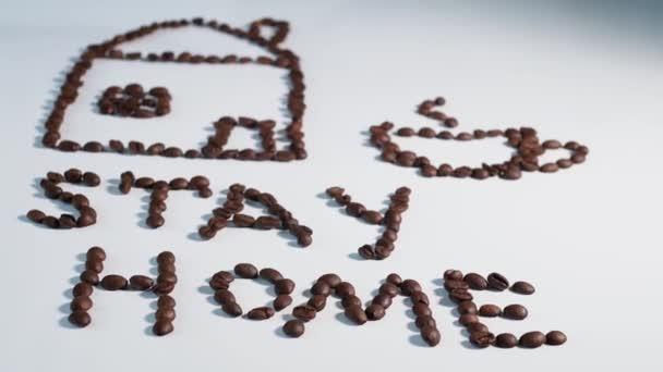 Rajz a kávébab fehér alapon, a felirat a kávé legyen otthon