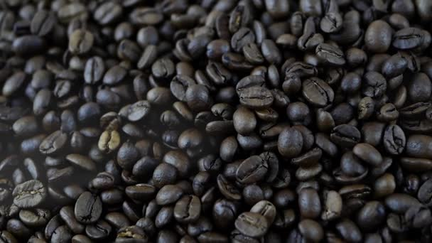 Coffee beans are roasted in smoke,processing of coffee beans close-up
